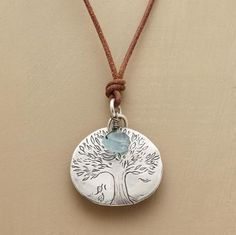 "Jes MaHarry's tree medallion is engraved  ""Honor earth animals and plants. "" In sterling silver, it's accented with a rough-cut aquamarine, on an oiled leather cord with sterling slider button to adjust the length. Handcrafted in USA exclusively for Sundance. Adjusts up to 36"