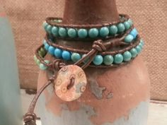 Amalie Peters Designs triple wrap beaded boho bracelet.  Stone beads, leather cord, wood button closure.  Check out this item in my Etsy shop https://www.etsy.com/listing/216011805/handmade-triple-beaded-wrap-boho