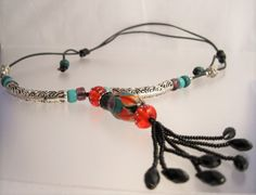 Bright orange, aqua and violet pendant necklace with black beaded tassel and leather cord