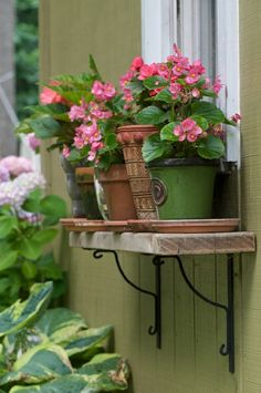 pots on a window sill instead of a window box. What a great idea.  I like it even better than a windowbox!!