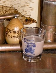 Southern Delight 2 oz. Palmetto Moonshine 4 oz. butter shots 2 tbsp. chocolate syrup 1 cup milk ice