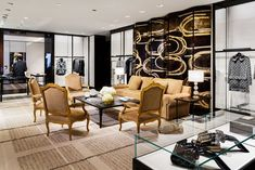 The boutique features references to Coco Chanel's famed Paris apartment, including a sofa styled after the fashion designer's own, standing in front of a Nancy Lorenz folding screen.