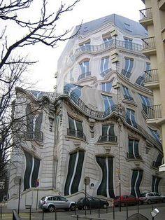 Unusual Building in Paris Daliesque screen concealing building renovation in Paris street. Architecture Unique, Plans Architecture, Futuristic Architecture, Classical Architecture, Pavilion Architecture, Sustainable Architecture, Residential Architecture, Unusual Buildings, Interesting Buildings