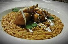 Orzo with braised chicken thighs.
