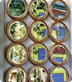 Mirror made from paint can lids, dollar store mirrors, and gold spray paint. LOVE!