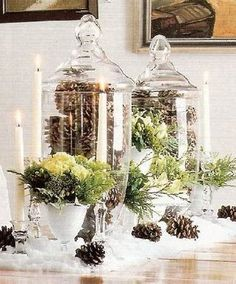 Apothecary Jars filled with pine cones and maybe some pine leaves with different hights of white candles. Christmas table--love!