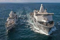 Royal Netherlands Navy JSS Karel Doorman on Trials Escorted by HNLMS Tromp.