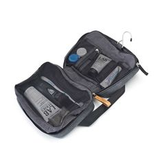 Pockets for your toiletries and toothbrush with a hook to hang it for best accessibility. Easy washable lining on the inside and smooth canvas on the outside. Camera Pouch, Travel Must Haves, Travel Kits, Traveling By Yourself, Gym Bag, Wallet, Zurich, Shoe Bag, Easy Access