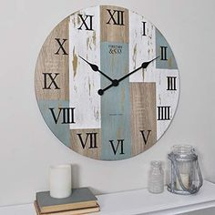 FirsTime FirsTime and Co.® Timber Planks Wall Clock at Lowe's. Nothing ties a room together better than a great clock, and the one you choose to place in your home should reflect your personality and style. Wall Clock, Clock, Upcycle Glass, Round Wall Clocks, Timber Planks, How To Distress Wood, Farmhouse Wall Clocks, Plank Walls, Wall Art Stores