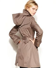 i like that this rain coat has a hood and belt. i like navy blue. prob xs is it's womens sizes