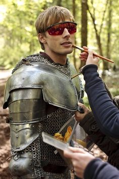 Because he doesn't trust Merlin to do his makeup.... =P