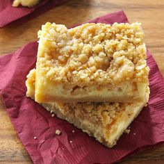 "Apple Caramel Cheesecake Bars Recipe -It's a caramel apple, cheesecake and streusel-topped apple pie all rolled into one irresistible dessert. If you can't resist a ""taste test"" before a party, just arrange them on a serving platter and no one will know a piece is missing from the pan! —Katherine White, Clemmons, North Carolina"