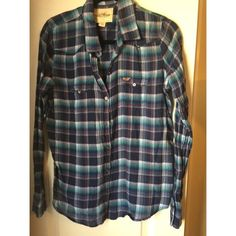 Blue Plaid Hollister Shirt Blue plaid Hollister button down shirt. Perfect condition, just don't wear Hollister anymore! For sale only, no trades :) Hollister Tops