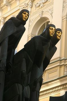 "son-of-dawn: "" Black-robed, gold-faced muses symbolizing Drama, Tragedy and Comedy on the facade of the National Drama Theatre in Vilnius, Lithuania sculpture by Stanislovas Kuzma "" Lithuania Travel, Poland Travel, Italy Travel, Drama Theatre, Theater, Europe On A Budget, Gold Face, Thinking Day, My Heritage"