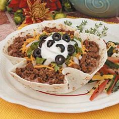Taco Salad with Baked Shells Recipe -Instead of using deep-fried salad shells, this recipe calls for baking flour tortillas in the microwave. Doing so keeps all the flavor and reduces the fat. Taco Salad Recipes, Taco Salads, Snack Recipes, Yummy Recipes, Mexican Dishes, Mexican Food Recipes, Ethnic Recipes, Mexican Meals, Creamed Beef