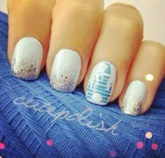 ...the castle from disney on the accent nail with sparkle tips on the others.