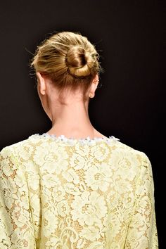 The Lazy Girl's Guide To Non-Boring Buns  #refinery29  http://www.refinery29.com/bun-hairstyle-inspiration#slide-6  Try The Ballerina, Off-Duty Look Sometimes, you gotta go sleek and pretty. Elizabeth Arden Red Door Spa created this style for Erin Fetherston's spring 2015 show: Pull hair into a low ponytail, spritz it with hairspray, secure with an elastic and bobby pins, split it into two sections and tie into a knot, and roll and pin the remaining sections. Cool '60s botanical prints and…