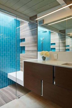 Mid-Century Modern Bathroom Ideas-36-1 Kindesign caribbean blue subway tile on the vertical, shower