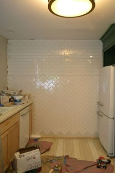 Love the herringbone + linear tiles for a tiled bathroom wall. Cost-effective way to add interest.