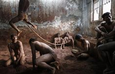 Wrestlers practise as others rest in the mud at a traditional Indian wrestling centre called Akhaara in Mumbai, March 4, 2014. Kushti (mud wrestling) is a traditional sport in India but more and more young athletes are now training to wrestle on mats instead of mud to gain access to top international competitions like the Olympic Games or the Commonwealth Games.