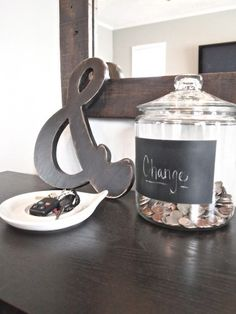 A giant glass change jar and key holder on the entryway table, where you can empty the jingles in your pockets as soon as you walk in the door! | cape27blog.com