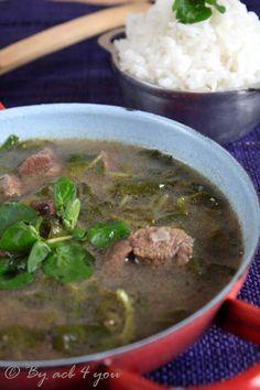 Romazava - National dish of Madagascar. Beef broth with anamalao, tomato, ginger and onion.