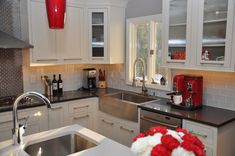After reading this site daily for 6 months now and getting tons of great advice it's time for us to post our finished kitchen. In keeping with the style of the house we needed to go more modern than traditional, but we didn't want something too contemporary. Also, we couldn't decide on painted or st...