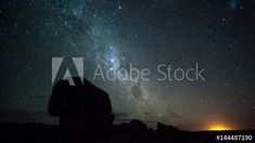 Linear pan and tilt timelapse of the rising Milky Way with silhouette rocks in the foreground with scattered clouds, starting at blue hour through the night until blue hour before sunrise, shot blowing out at the end available on request Before Sunrise, Blue Hour, Rock Formations, Milky Way, Windmill, Tilt, Geology, Stock Footage, South Africa