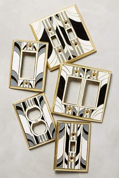 Very cool in an Art Deco bathroom remodel. Retro Swirl Switch Plate - anthropologie.com.
