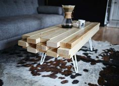 Very easy furniture building project to make with 2 x4 wood boards and table legs. Would look interesting with alternating wood stains.