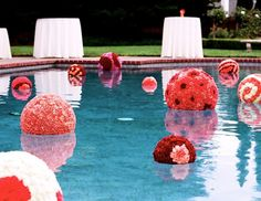 if the venue has a pool or some body of water, floating decor is the perfect accent and your guests will never expect floating pomanders