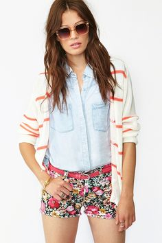 love the whole look.  Denim workshirt, stripe cardigan, floral print shorts.  Perfect effortless style