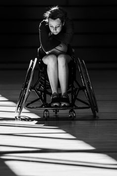 Young woman at a wheelchair basketball training session.