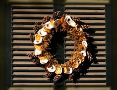 oyster shell wreath with pinecones - interesting take on wintertime!