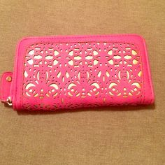 NY&C wallet Brand new never been used. This is a nice sized wallet that can fit all ur credit cards, cash, and change. It's a bright fuscia color with gold backing. New York & Company Accessories