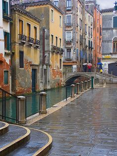 Rita Crane Photography:  Italy / Venice / rain / umbrellas / buildings / people / bridge / canal / Cannaregio Rain, Venice