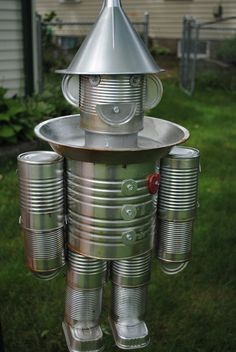 Tin man bird feeder- made out of soup cans, pie tin, sardine cans and an oil funnel