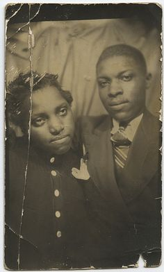Vintage photobooth photo.... Boy, she looks thrilled to be posing for this photo!  I think someone has gotten himself into some deep doo-doo over something!  I bet the car ride home was fun!