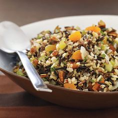 Wild Rice Dressing | MyRecipes.com  For the vegetarian version substitute the chicken broth with vegetable broth