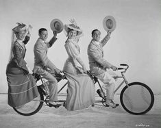 Take Me Out to The Ball Game 1949- Such a cute movie-Full publicity shot of Betty Garrett as Shirley Delwyn, Frank Sinatra as Dennis Ryan, Esther Williams as K.C. Higgins and Gene Kelly as Eddie O'Brien, on bicycle built for four.