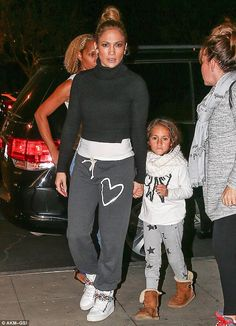 Yummy mummy: Jennifer Lopez dressed down to take her twins Emme and Max Muniz to see Big Hero 6 in Calabasas, California on Saturday