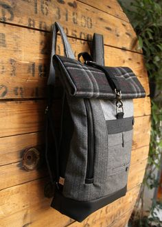 Handmade gray upcycled roll top rucksack ideal for excursions, travelling, biking and not only, it can be the perfect stylish accessory for everyday use. A blend of various pieces of textiles in different shades of gray have been used in order to create this rucksacks patchwork.