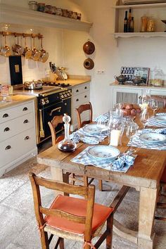 Love farmhouse table in kitchen