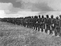 """Soldiers of the 369th (15th NY) Regiment, """"Harlem Hellfighters"""", standing in line on the Western Front."""