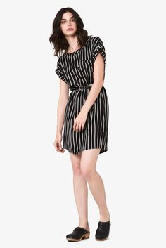 Relaxed short-sleeved shift dress with a single chest pocket by Portland brand Bridge & Burn. This go-anywhere shift dress is offered in flowing rayon for an all-in-one fit that can be dressed up or d