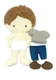 "Boy felt doll with outfit. Perfect addition to our girl felt dolls. Doll measures approx 5""X7"" and is made of with a layer of soft felt and a very heavy stabilizer on the back. Dolls will stand the he"