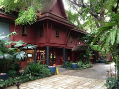 The Jim Thompson House- . Proceed to the lovely former home of Jim Thompson. Enjoy lunch at the excellent restaurant and then explore the grounds and his art collection; the traditional-style teak home is a must for admirers of Thai antiques and interior design.