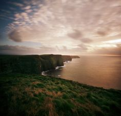 """these are the places i will always go"" by manyfires on Flickr - The Cliffs of Moher, Ireland...photographed at sunset"