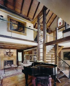 I love this barn house!  The elegance  of the interior is a great contrast to the primitive architectural elements.
