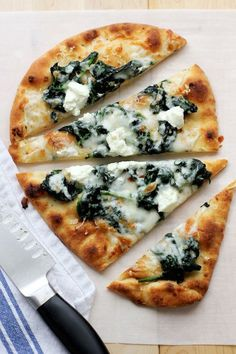 An easy, tasty flatbread pizza featuring garlicky spinach and tangy goat cheese…. An easy, tasty flatbread pizza featuring garlicky spinach and tangy goat cheese. Perfect for lunch or dinner with a simple green salad. Think Food, Love Food, Vegetarian Recipes, Cooking Recipes, Healthy Recipes, Kitchen Recipes, Goat Cheese Recipes, Goat Cheese Pizza, Salads With Goat Cheese